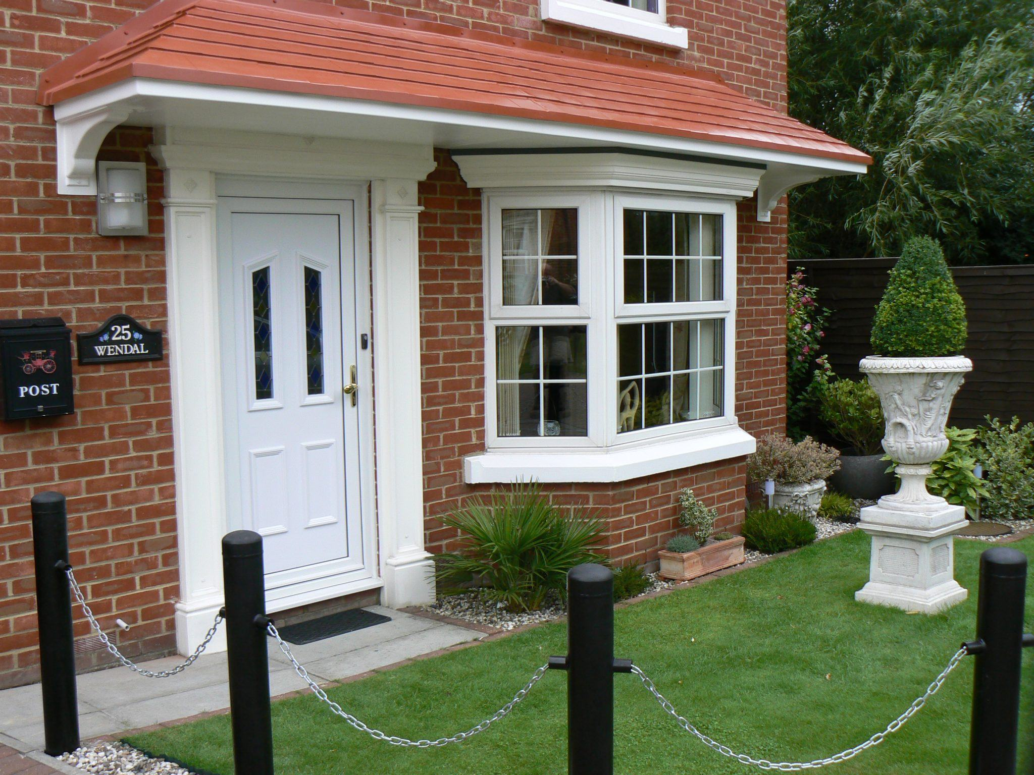 The benefits of a door canopy canopies uk for Best windows for new house